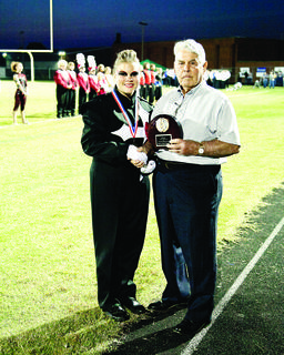 Cecil Mather presented the reserve grand champion trophy to Russell Countys band.