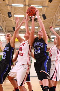 Nelson County's Allysa Johnston (21) is sandwiched between LaRue County's Alisha Durbin, left, and Ivy Brown as they go after a rebound.