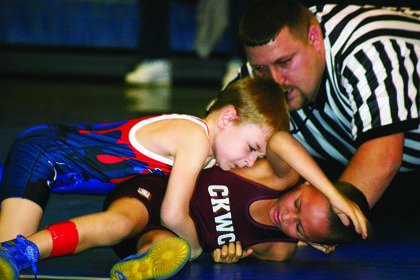 LaRue County's Lucas Barnes, on top, tries to control A.J. Williams of Campbellsville.