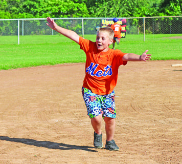 Ryan Hughes, son Hodgenville Elementary School Principal Eric Hughes, ran and shouted during the kickball game.