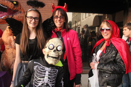 Skelton Zach Devers was shocked at all the activity on the square that is caused him to be bug-eyed. Pictured in the back from left are LeeAnne Devers, Alexis Basil and Michelle Miller.