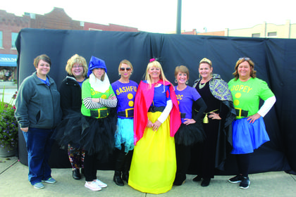 Members from the LaRue County Chamber of Commerce Board of Directors dressed up as Snow White aka Sandy Kidd and the seven dwarves .