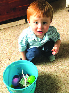 Clay Stults, 2, of Hodgenville shows off his Easter bucket of goodies.