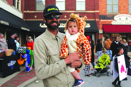 Josh McDowell of Hodgenville is pictured holding his giraffe, his son Kolton McDowell, 1.