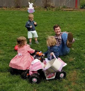 Skyler Hornback, 18, of Sonora gets wiped out by his nieces hunting Easter eggs on four wheelers. On four wheelers are Emma Nunn (16 months), Mattie Davenport (2) and Grayson Davenport (2) who is watching.