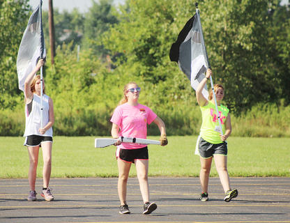 Pictured from left are color guard members Sydney Lee, Savannah Smith and Helen Clater.