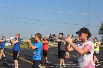 The brass section of the Band of Hawks practices their marching formation.