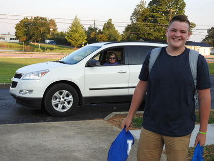 Eighth grader Elam Stillwell is ready with her UK gear on the first day of school.