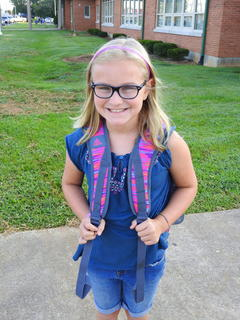 Sixth grader Addison White is all smiles on her first day back to school.