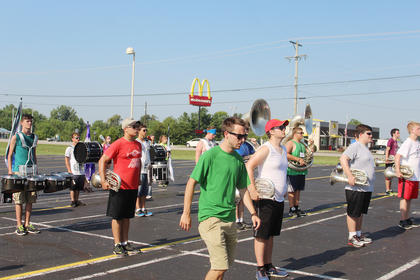 LCHS Band Director Alex Patterson analyzes the marching band during their practice at summer camp last Thursday.