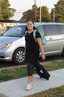 Seventh grader Clara Walsh is going to do some serious studying this year as she is packing two backpacks.