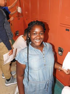 Seventh grader Isis Barbour opens her locker for the first time this school year.