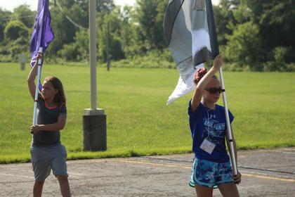The color guard is getting in rhythm for the news season. Pictured from left are Braley Dupin and Amadee Fields.