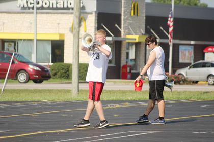 Baritone players Seth Lawson and Bryan Downs are shown practicing their marching drills.