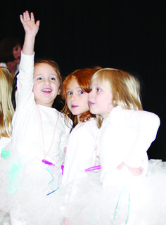 Local schools held holiday programs last week. Above, Hodgenville Elementary School kindergarten students Mackenzey Rucker, Nikki Blair and Abby Goodin performed.