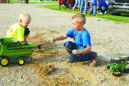 Braden Williams and Conner Gibson played with farm toys in the mud.
