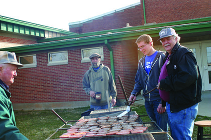 LaRue County Pork Producers Billy Dunn, Mike Lee, James Reding and Jimmy Wood grilled burgers at the Extension Expo.