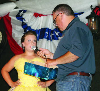 Olivia Bingham, 10, answered a question she selected from a box during the Miss Pre-Teen contest. The emcee was Cale Tharp.