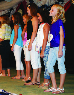 Abigail Elizabeth Riggs, 9, far right, the daughter of Steve Riggs and Crystal Rust, smiled at the crowd during the Miss Pre-Teen contest.