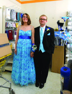 Sarah Herron and Tyler Stillwell asses a touch of glamour to Hodgenville's Dollar General Store. hey stopped by Tyler's workplace Saturday before attending the LaRue County High School Prom.