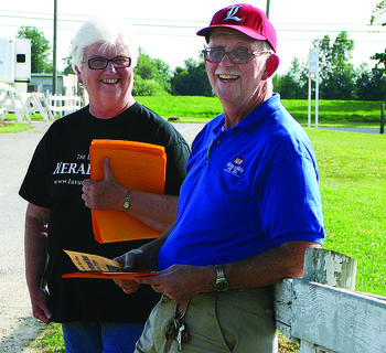 The LaRue County Herald News' employees Hazel Hinton and Randy Williams passed out flyers to fair-goers on The LaRue County Herald News' Night at the Fair.