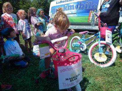 Reese Bratcher of Hodgenville won a bike donated by Magnolia Bank.