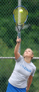 LaRue County's Amelia Miller serves the ball in a doubles match during the region tournament Friday at University Drive Park in Elizabethtown.