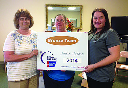 Shirley Jaggers and Rosetta Lafollette accept Bronze Team recognition from Kristin Darrow for $3,634.39 raised by Freedom's Angels.