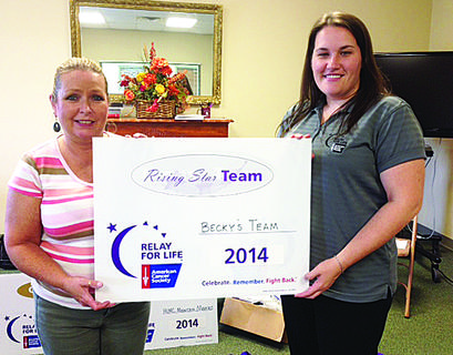 Becky Thompson accepts Rising Star status from Darrow for her team, Becky's Team, raising $1,220.34.