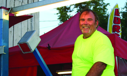 Rick Wheeler smiled at the crowd as he grilled hamburgers at his booth at the LaRue County Fair.