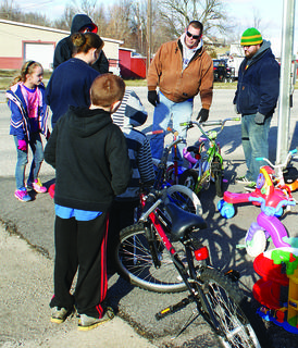 Volunteer Robbie Redmon helped children pick out bicycles.