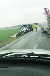 A salt truck overturned on KY 84.