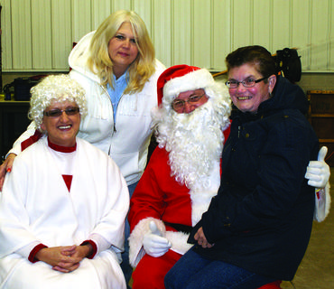 Members of Wesley Meadows Methodist Church volunteered to help with the Christmas Eve Santa Run. Sue Votaw and Sandy Claywell visited with Santa and Mrs. Claus (Tom and Phyllis Smith).