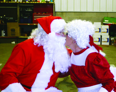 Santa (Tom Smith) gave Mrs. Claus (Phyllis Smith) a smooch as they waited for the children to arrive on Christmas Eve.