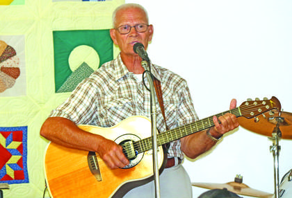 Charles Riggs sang and played guitar on Senior Day at the LaRue County Fair.