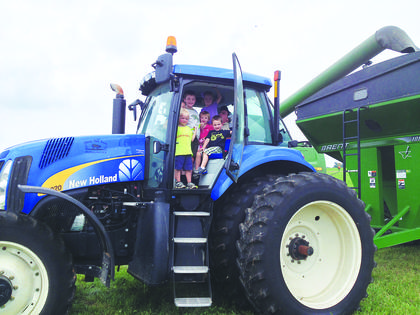 Scott Miller was surrounded by children in the cab of this tractor at Shady Rest Farm.