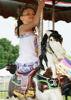 Kara Spear rode side-saddle on the merry-go-round.