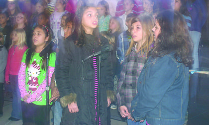 Hodgenville Elementary School students sang at Saturday's Lighting of the Square. From left, Kaylee Whiteman, Bella Venegas, Chole Sisneros and Mercy Williams.