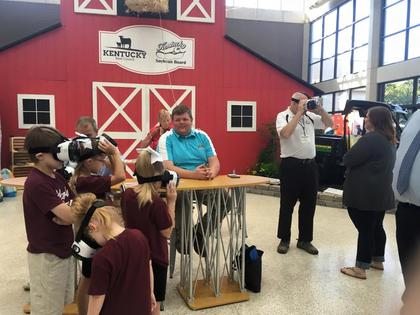 Caleb Ragland is shown working in the KY Beef Council and KY Soybean Board booth where visitors could experience virtual reality 360 views of a variety of farm activities.