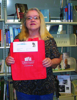 The adult summer reading program is in full swing at the LaRue County Public Library. For each book read, participants can enter a drawing for a $5 gift certificate to Lincoln Loft. A library book bag will be given away each Friday at noon in June and July. A grand prize will be given away Aug. 1. Above, Janet Smith was the winner on June 13