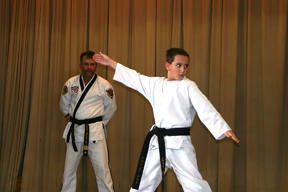 Chase Hines concentrates on his forms during an exhibition for Sallee's Family Taekwondo at the Extension Expo.