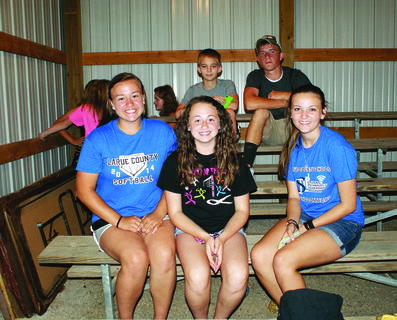 Emma Bell, Taylor Newton, Megan Hawkins, James Akin and Keith Powers socialized in the Morrison Building at the LaRue County Fair.