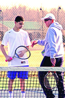 LaRue County High School tennis coach Roger Pierce offered advice to Alex Best.
