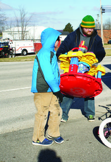 Volunteer Tom Pitt carried bikes and ride-on toys from a trailer.