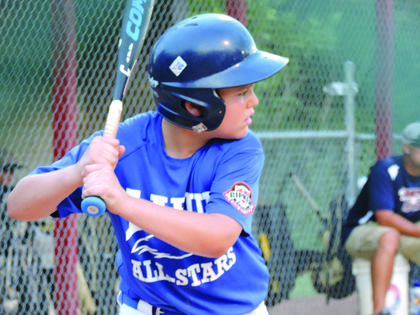 Tommy Wilmoth at bat during the 8-year-olds All-Star District Tournament held in Elizabethtown. He hit the ball over the fence during this at bat.
