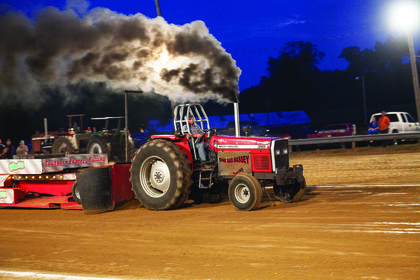 A tractor pulled a weighted sled down the track in Friday's tractor pull.