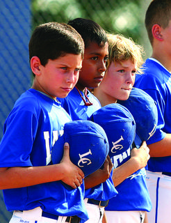 Curtis Ford, Junior Vazquez and Brandon Hollis stood at attention during the playing of the National Anthem at the opening of the West Kentucky Cal Ripken State Tournament at LaRue County Park and Recreation.
