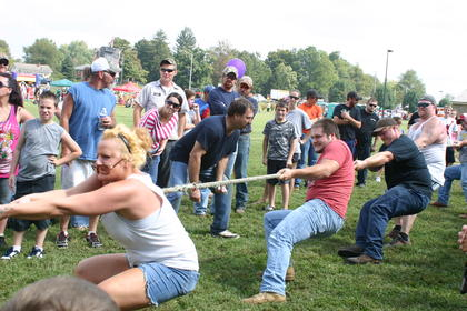 Arms strain and sweat breaks out as this tug-of-war team pulls with all their might.