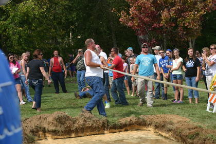 Tug-of-war participants finally let go of the rope after admitting their defeat.
