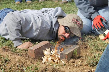 Tyler Adams of Upton Gang blew hard on his fire during the water boil, but Dean's Gang eventually won the event.